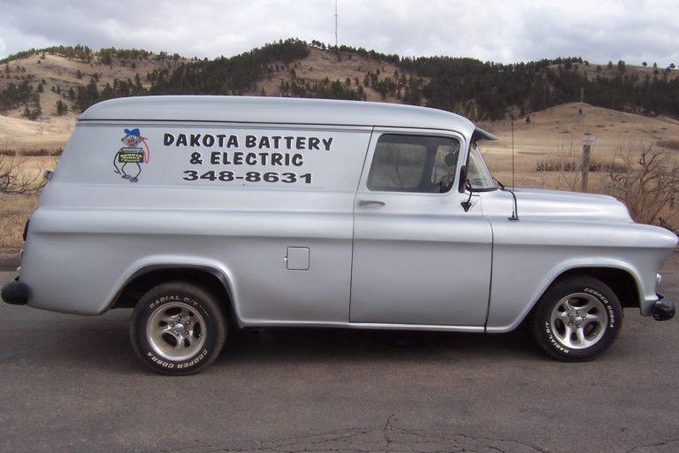 Classic Car With Dakota Battery Signage